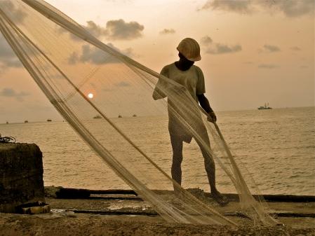 Man organising Fishing Nets