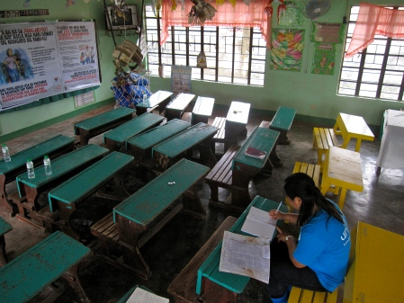 Mrs. Loreniano awaits children's return after most are unaccounted for folllowing Typhoon Bopha.